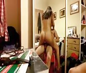 Amateur cock-jockey fucks in front of a large mirror