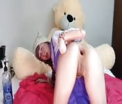 Dresses up like a schoolgirl giving herself anal