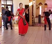 Doing a dance in her sari