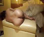 Beating her pussy from behind on cam