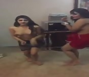 Two topless teens dancing