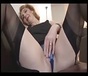 MILF with a hot body in stockings playing