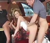 Blonde MILF fucks two young bucks at the bar