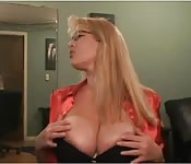Blonde MILF and her big tits on cam