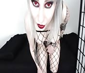 Platinum blonde goth with big tits and a hot ass plays