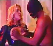Lisa Brunet in latex dungeon scene