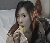 Asian girls eating bananas