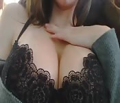 Brunette plays cock tease with her big round tits