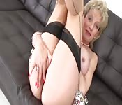 Horny MILF with big tits playing with her wet pussy