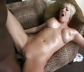 Blonde having fun with a black cock