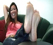 Sexy Asian woman shows off her feet