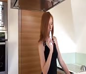 Redhead playing with a dildo
