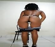 A sexy black slut giving a strip tease.