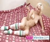 Pierced blonde prods her cunt with toy