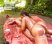 Oily Brazilian babe mounts it outdoors