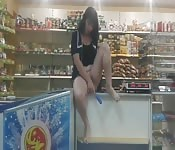 Amateur brunette plays with herself in a store