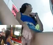 Latina bitch playing with herself at the store